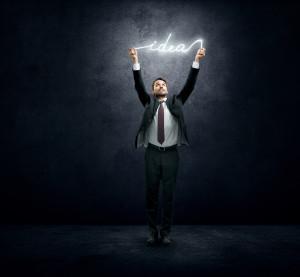 Businessman holding luminous idea
